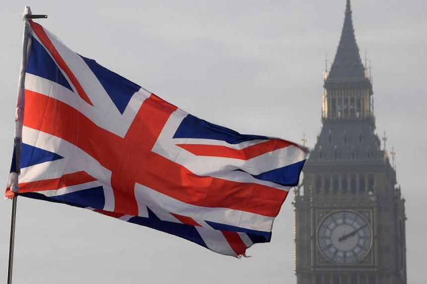 A Union flag flies in front of the Big Ben clock tower in London.