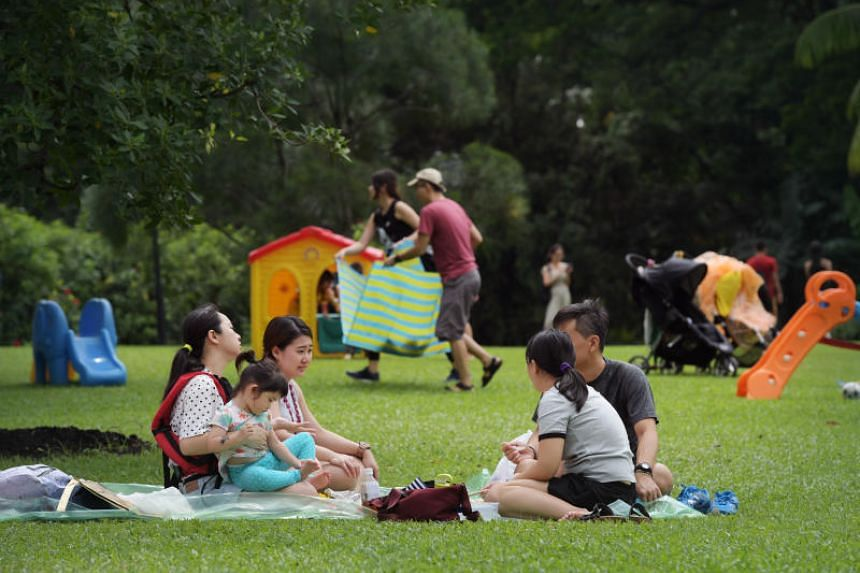 Visitors enjoy a picnic on the lawn at the Istana Open House on Labour Day.