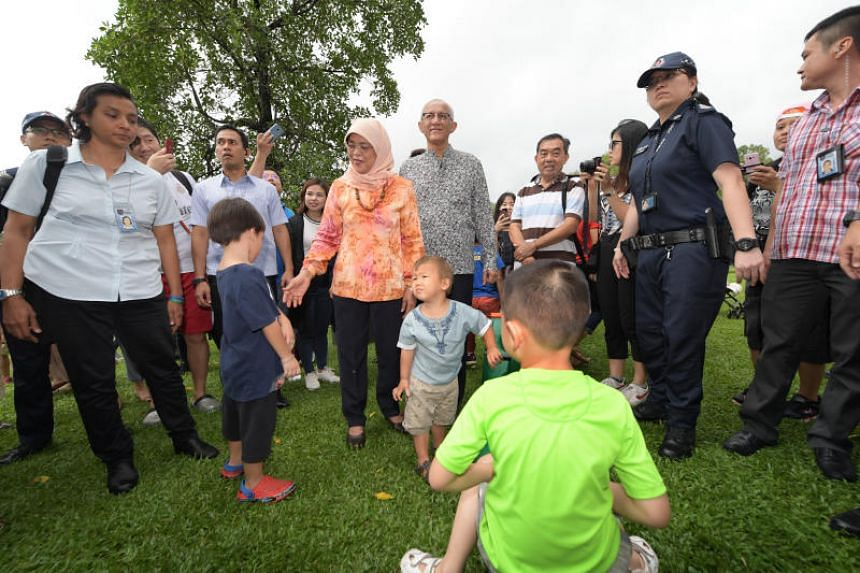 President Halimah Yacob and husband Mohamed Abdullah Alhabshee greet visitors and pose for photographs at the Istana Open house on Labour Day.