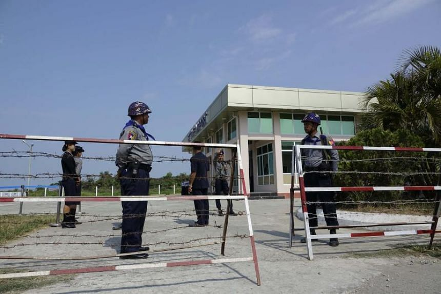Military police stand guard at the Sittwe airport after members of a United Nations  Security Council team arrived, in Rakhine State, Myanmar, on May 1, 2018.