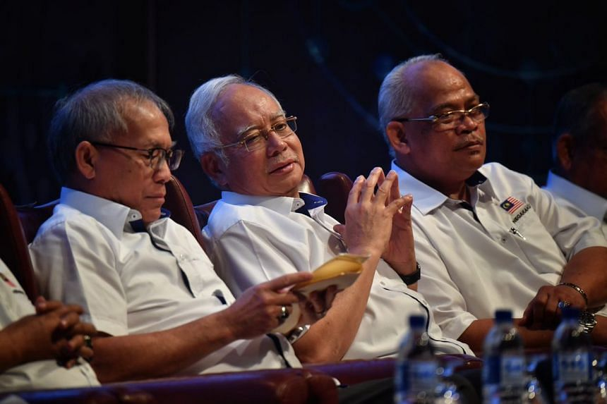 Malaysia's PM Najib Razak (centre) announced a slew of promises if his Barisan Nasional (BN) coalition is returned to power on May 9.
