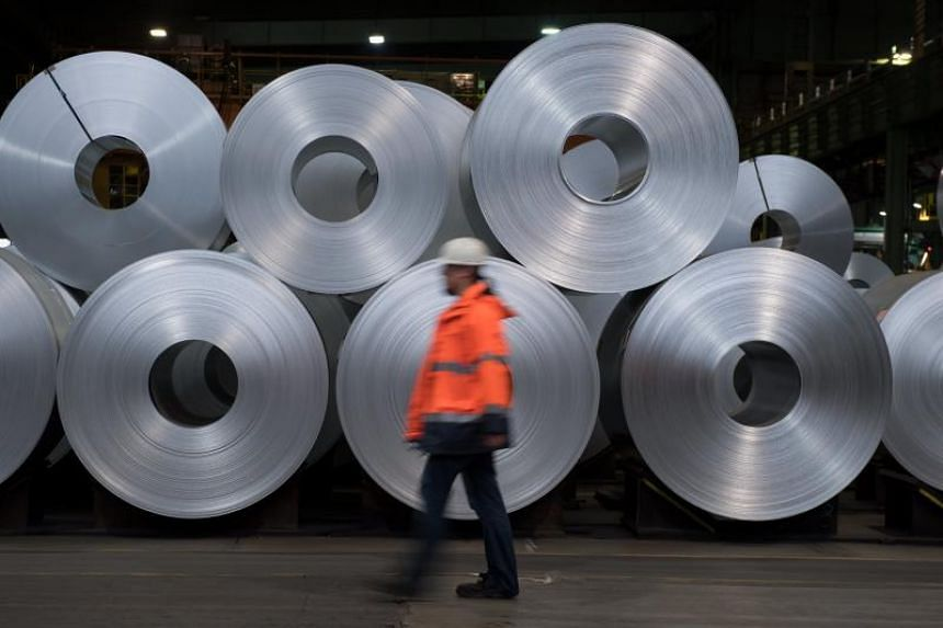 Steel collies from German steel manufacturer Salzgitter AG are stored in Salzgitter, Germany, on March 22, 2018.