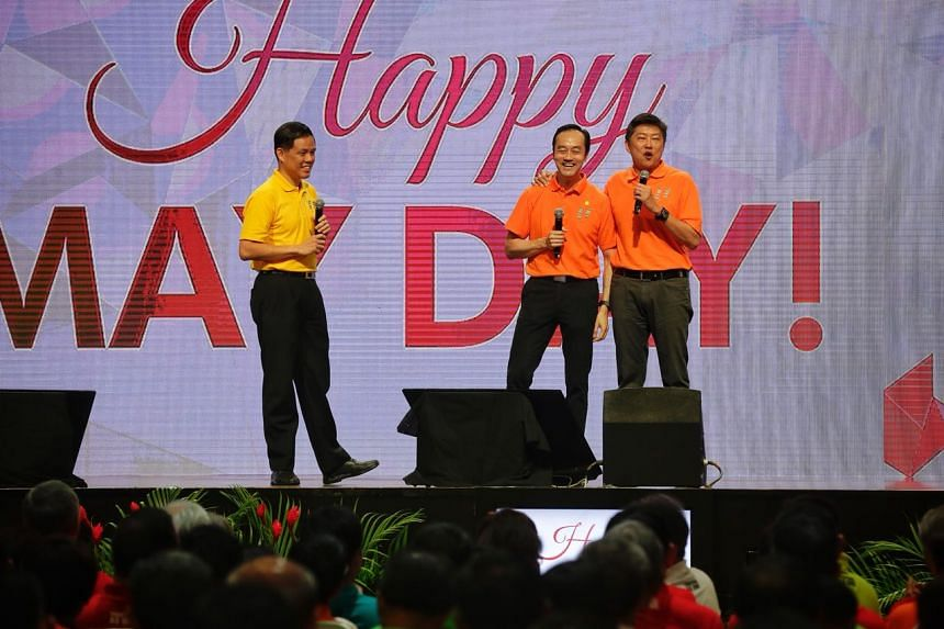 Labour chief Chan Chun Sing (left) with deputy secretary-generals Koh Poh Koon (centre) and Ng Chee Meng on stage during the May Day Rally at D'Marquee in Downtown East on May 1, 2018.