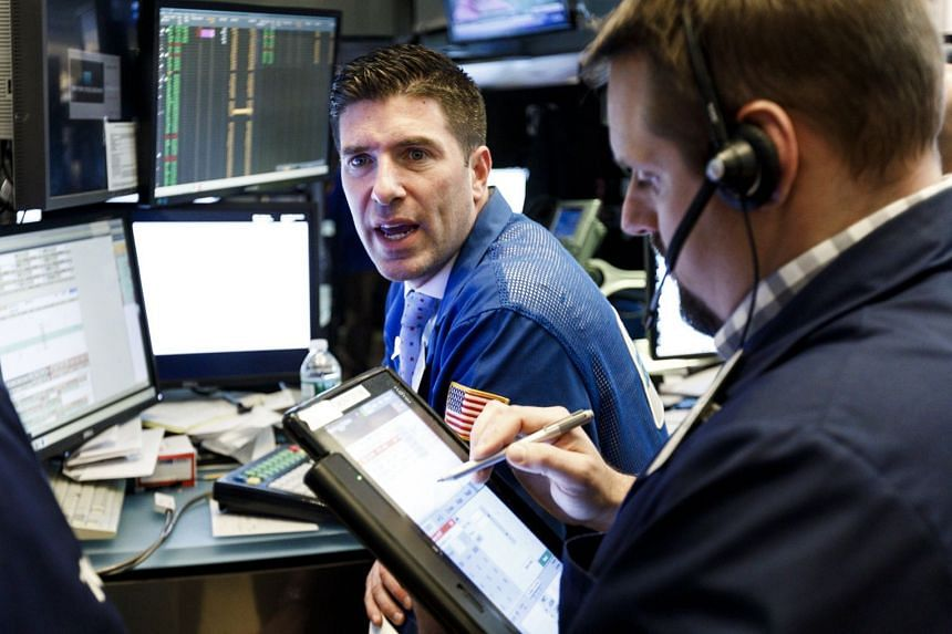 Traders work on the floor of the New York Stock Exchange on May 1m 2018.