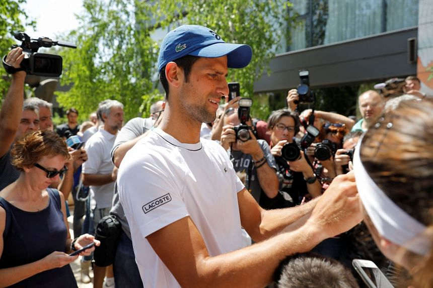 Djokovic signs autographs after a training session in Belgrade, Serbia, May 2, 2018.