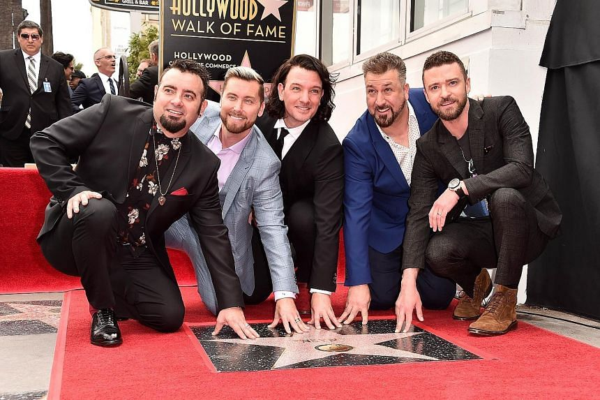 (From left) Chris Kirkpatrick, Lance Bass, JC Chasez, Joey Fatone and Justin Timberlake of NSync with their Hollywood star.