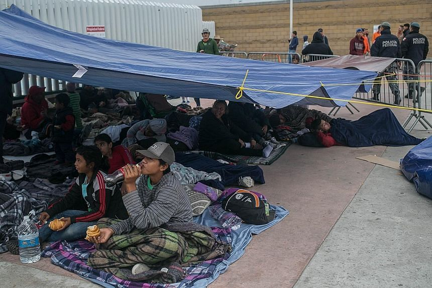 Members of a caravan of migrants from Latin America who had travelled through Mexico camping at Tijuana's border crossing with the US on Monday.