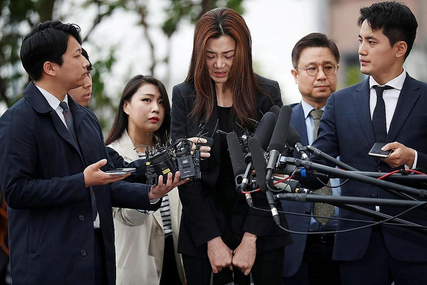 Ms Cho Hyun Min yesterday apologised repeatedly at her first appearance since allegations that she threw a drink at people during a business meeting last month.