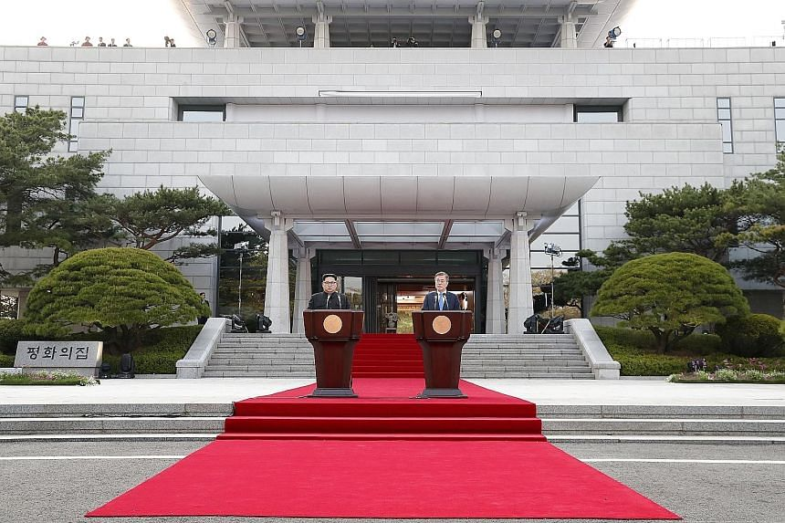 North Korean leader Kim Jong Un (left) and South Korean President Moon Jae In outside the Peace House in the border village of Panmunjom after their summit last Friday. US President Donald Trump is considering the same venue for his meeting with Mr K