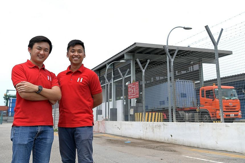 Maritime and logistics start-up Haulio co-founders Sebastian Shen (wearing watch) and Alvin Ea.