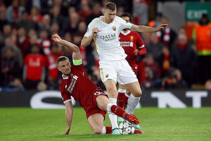 Roma's Edin Dzeko being tackled by Liverpool's Jordan Henderson in their Champions League semi-final first leg at Anfield, which the Reds won 5-2. The five-time European champions have never given up a first-leg advantage of three goals or more in Eu