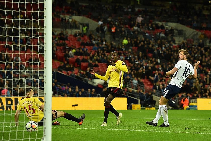 Tottenham striker Harry Kane scores his side's second goal in the 2-0 Premier League win over Watford at Wembley on Monday. He now has 27 league goals, four fewer than Mohamed Salah.