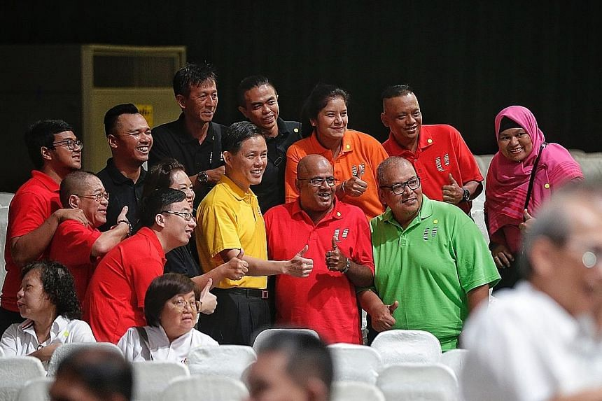Outgoing NTUC secretary-general Chan Chun Sing (in yellow) posing for a photo with May Day Rally attendees yesterday. Several unionists described him as a warm and approachable leader with a sharp intellect.