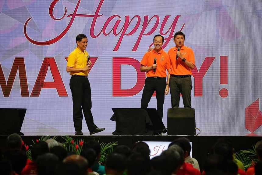 NTUC secretary-general Chan Chun Sing (far left) introducing deputy secretaries-general Koh Poh Koon (centre) and Ng Chee Meng on stage during the May Day Rally at D'Marquee in Downtown East yesterday. Mr Ng is set to succeed Mr Chan as labour chief,