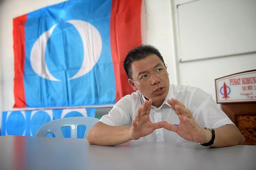 Above: Mr Mah Siew Keong, president of BN coalition partner Gerakan, on a walkabout in Teluk Intan, Perak, on Sunday. The ward has been held equally by BN and the opposition in the past four elections. Left: Mr Nga Kor Ming, DAP's national deputy sec