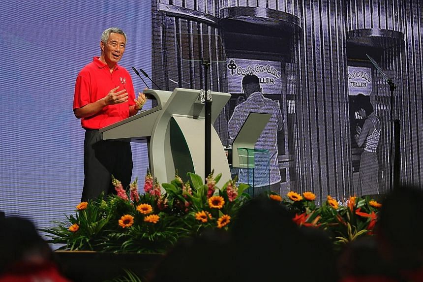 """Prime Minister Lee Hsien Loong speaking at the May Day Rally at D'Marquee in Downtown East yesterday. Addressing the audience of unionists, PAP ministers and MPs as well as employers, he noted that tripartism """"has seen us through every crisis since i"""