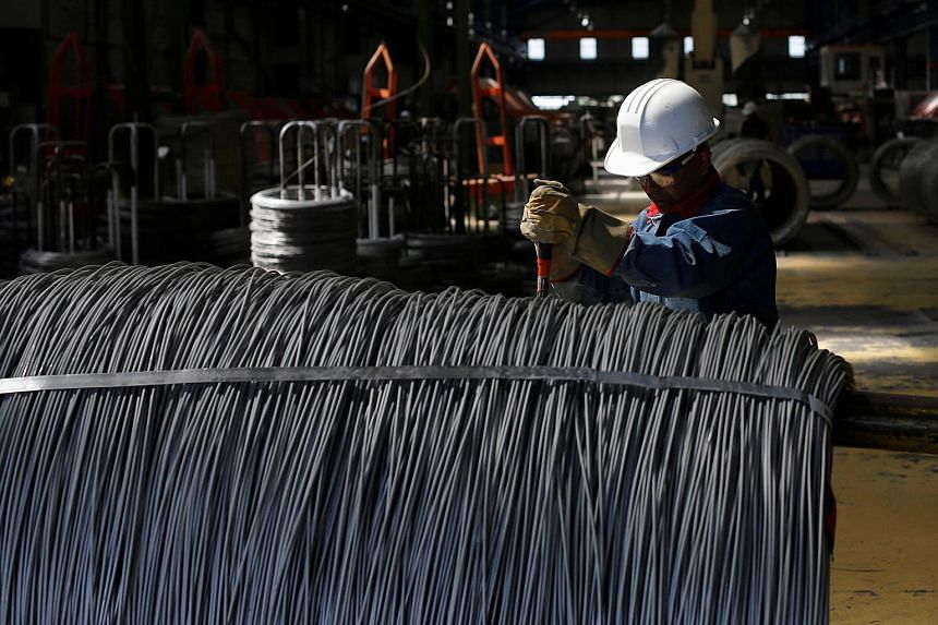 A worker at a stainless steel wire factory in Huamantla, Mexico. In March, US President Donald Trump imposed a 25 per cent tariff on steel imports and a 10 per cent tariff on aluminium, leading to increased friction with the US' trading partners worl