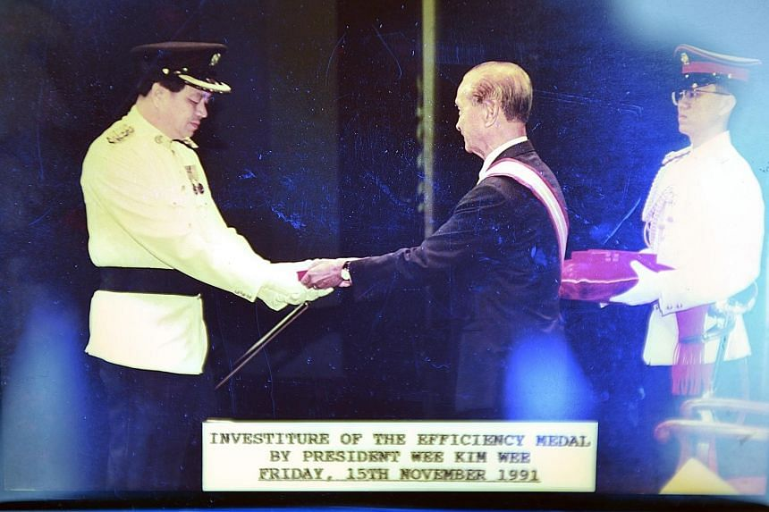Mr Lee Swee Thin retired as a police superintendent in 2004 but was rehired as a consultant. In 2012, he decided to set up a firm to train government officials on investigation methods. (Top) Mr Lee with two commendation certificates that he received