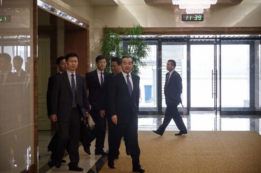 China's foreign minister Wang Yi (centre) arrives at Pyongyang international airport, on May 2, 2018.