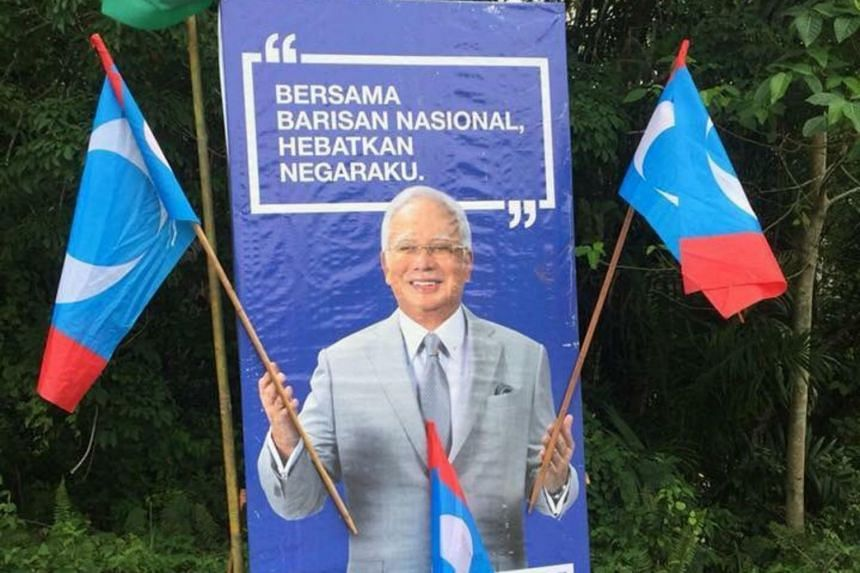 Parti Keadilan Rakyat flags were stuck over the photo of Prime Minister Najib Razak, so it looked like he was cheering on the opposition.