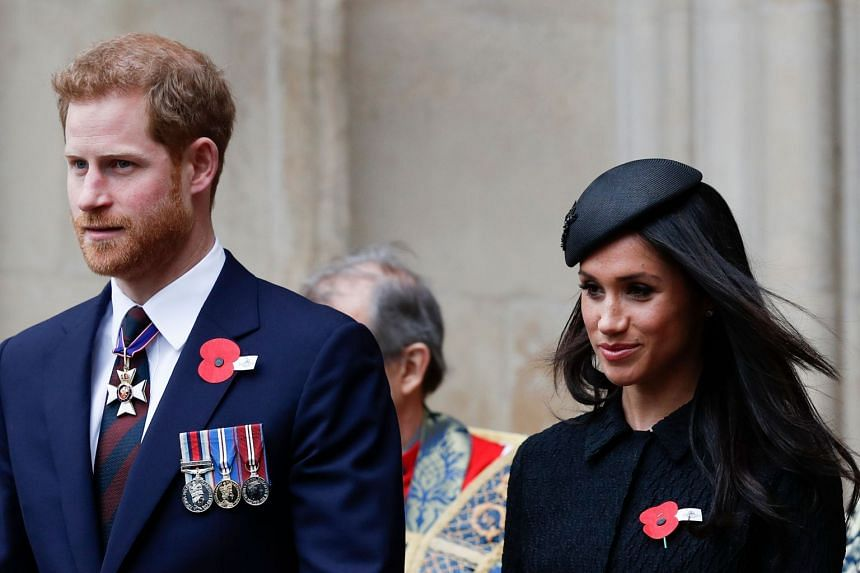 Britain's Prince Harry (left) and his fiancee US actress Meghan Markle leave after attending a service of commemoration and thanksgiving to mark Anzac Day in Westminster Abbey in London, on April 25, 2018.