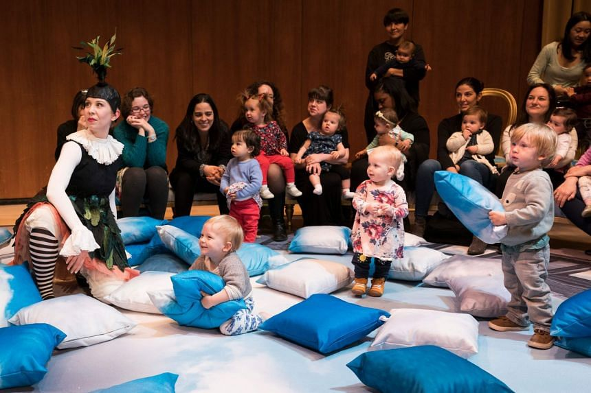 Mothers and children listen during the presentation of BambinO at the Metropolitan Opera House in New York, on April 30, 2018.