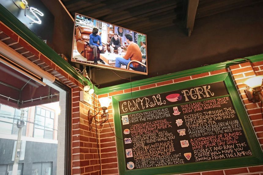 A television palys the US television sitcom Friends at the Central Perk coffee shop in Shanghai.