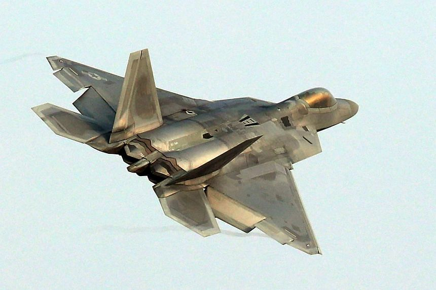 File photo showing a US Air Force F-22 Raptor stealth jet flying over a South Korean air base in Gwangju on Dec 4, 2017.