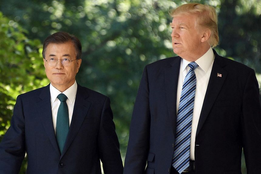 South Korean President Moon Jae In (left) and US President Donald Trump arrive to give a joint press conference in the Rose Garden at the White House in Washington, DC, on June 30, 2017.