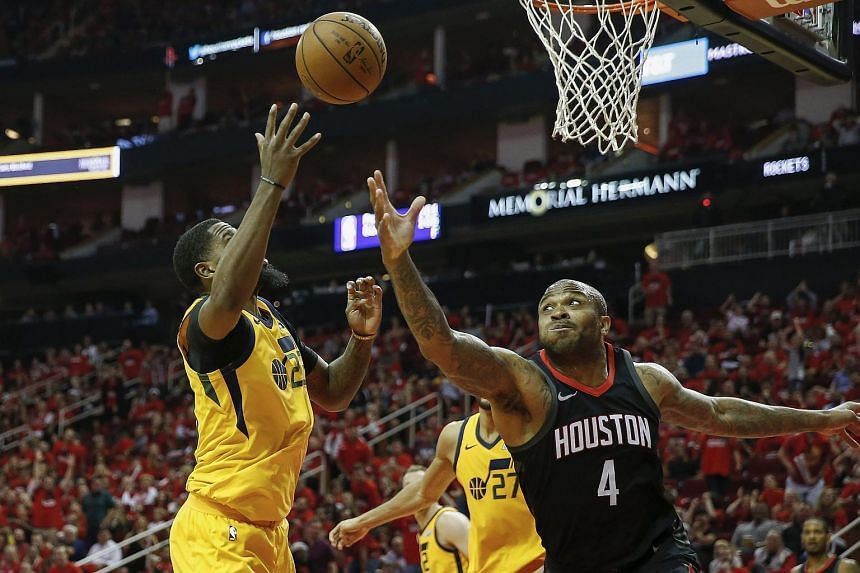 PJ Tucker #4 of the Houston Rockets and Royce O'Neale #23 of the Utah Jazz battle for a rebound in the second half during Game One of the Western Conference Semifinals of the 2018 NBA Playoffs, on April 29, 2018.
