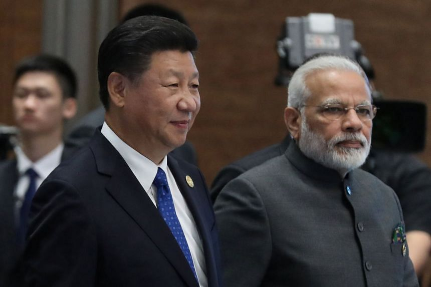 Chinese President Xi Jinping (left) and Indian Prime Minister Narendra Modi at a summit in Xiamen, China, on Sept 5, 2017.