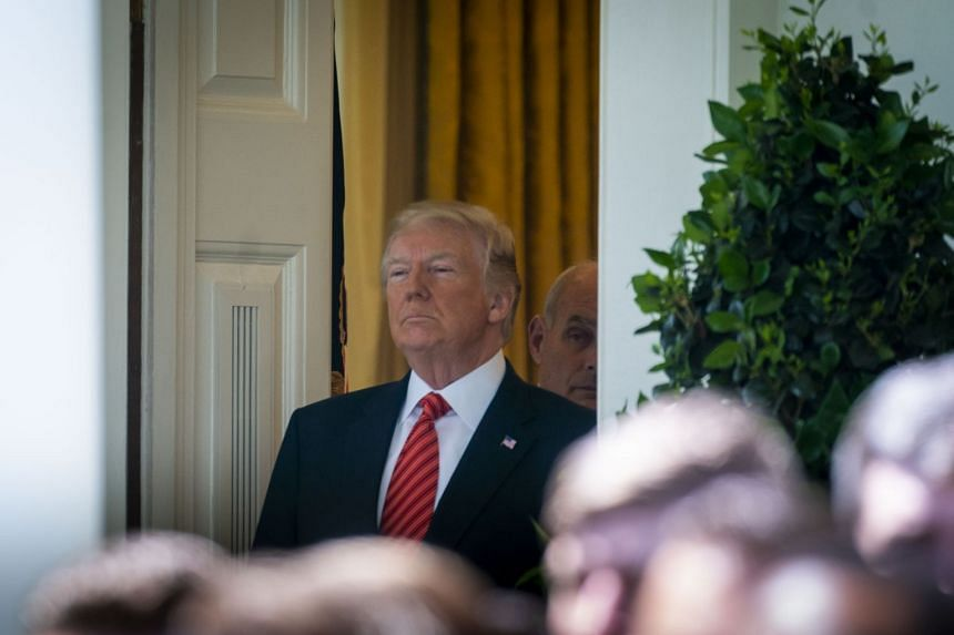 Donald Trump arrives in the Rose Garden for an event at the White House in Washington, May 1, 2018.