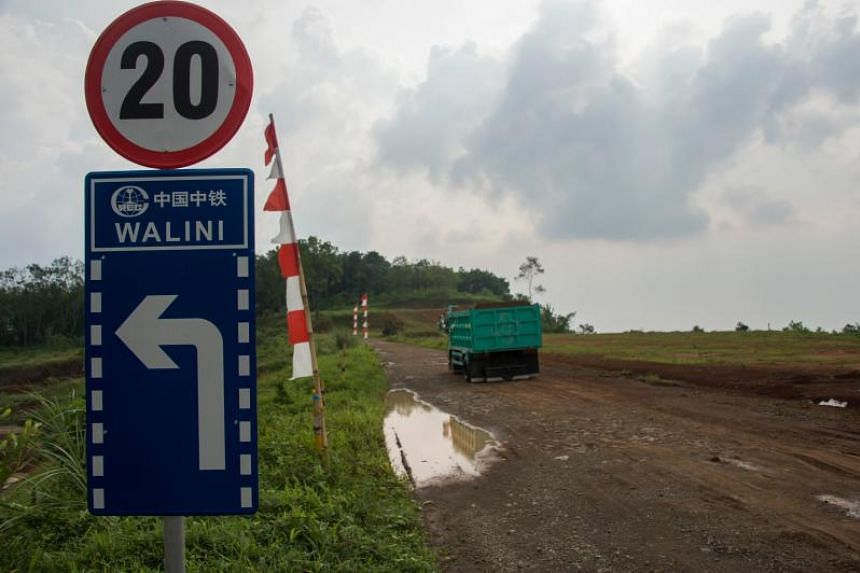 A sign is erected on the land where the Jakarta-Bandung high-speed rail will be constructed in Bandung, West Java province on Oct 20, 2017.