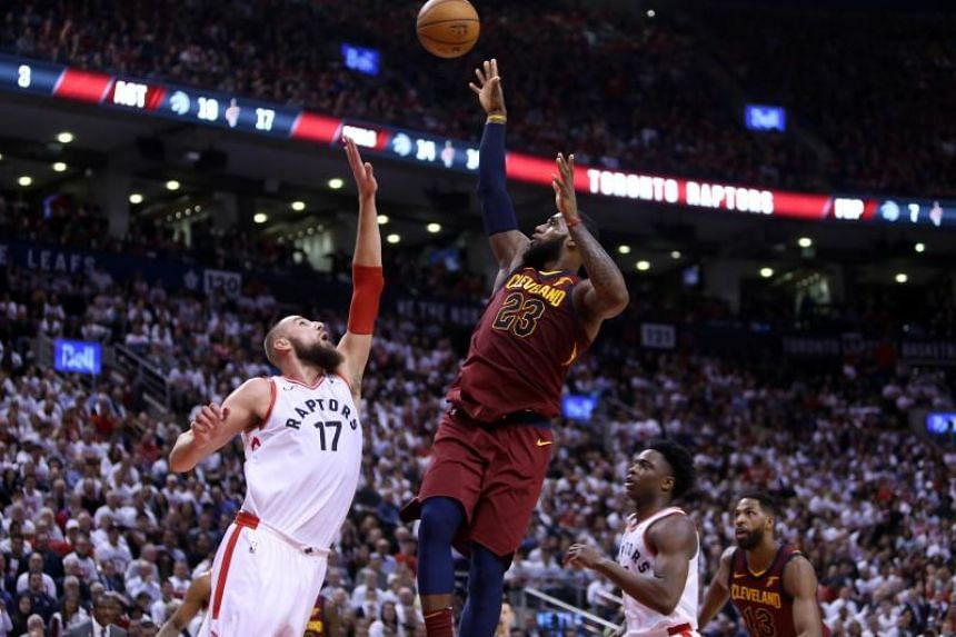 LeBron James of the Cleveland Cavaliers shoots the ball as Jonas Valanciunas of the Toronto Raptors defends in the second half of Game One of the Eastern Conference Semifinals during the 2018 NBA Playoffs at Air Canada Centre on May 1, 2018.