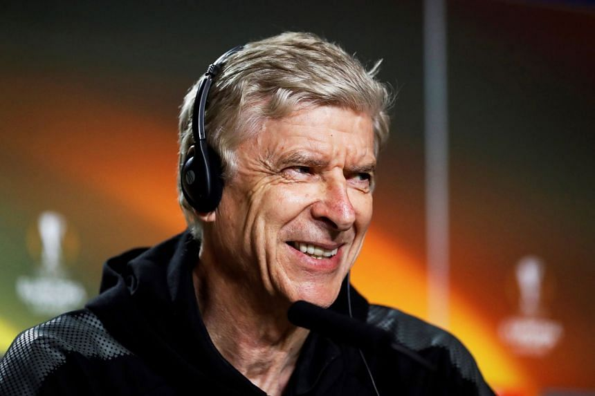 Arsenal's manager Arsene Wenger smiles during a press conference in Madrid.