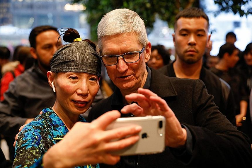 Apple chief executive Tim Cook taking a wefie with a customer at an Apple Store in Chicago, Illinois, in March. Apple posted revenue for its March quarter of US$61.1 billion, up from US$52.9 billion last year.