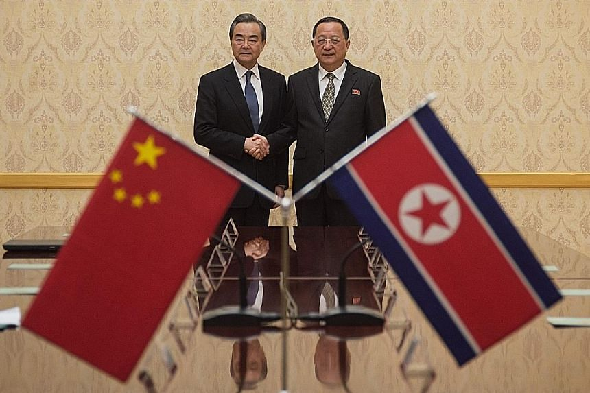 Chinese Foreign Minister Wang Yi (left) meeting his North Korean counterpart Ri Yong Ho in Pyongyang yesterday. The two top diplomats had met in Beijing last month.