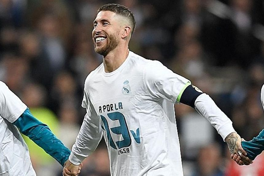 Top: Real Madrid's French forward Karim Benzema (right) celebrating with his team-mates after scoring a second goal (above), following a howler by Bayern Munich goalkeeper Sven Ulreich during the Champions League semi-final return leg at the Santiago