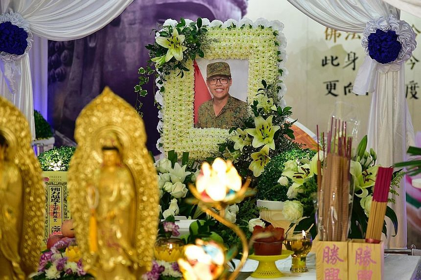 Corporal First Class David Lee Han Xuan's parents, Madam Jasmine Yeo and Mr Dennis Lee, and his sister Joey Lee called a press conference yesterday at the void deck of their block, where CFC Lee's funeral wake (below) is being held, to ask the public