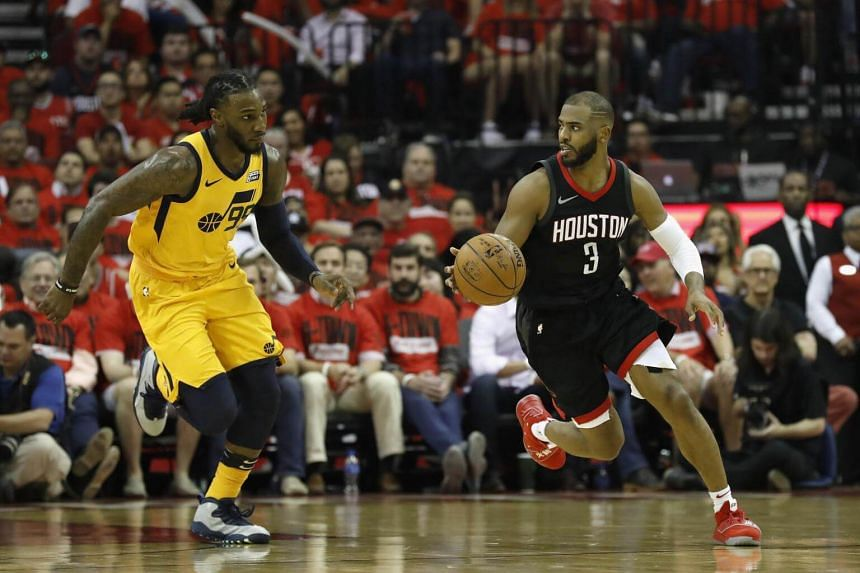 Chris Paul (right) of the Houston Rockets dribbles the ball on a fast break pursued by Jae Crowder of the Utah Jazz at the Toyota Center in Texas, on April 29, 2018.