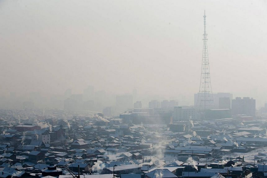 Smoke rising from chimneys of houses amid smog on a polluted day in Ulaanbaatar, on Jan 21, 2018.