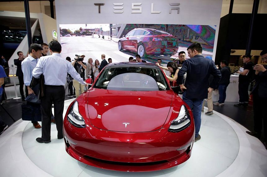 A Tesla Model 3 car is displayed during a media preview at the Auto China 2018 motor show in Beijing on April 25, 2018.