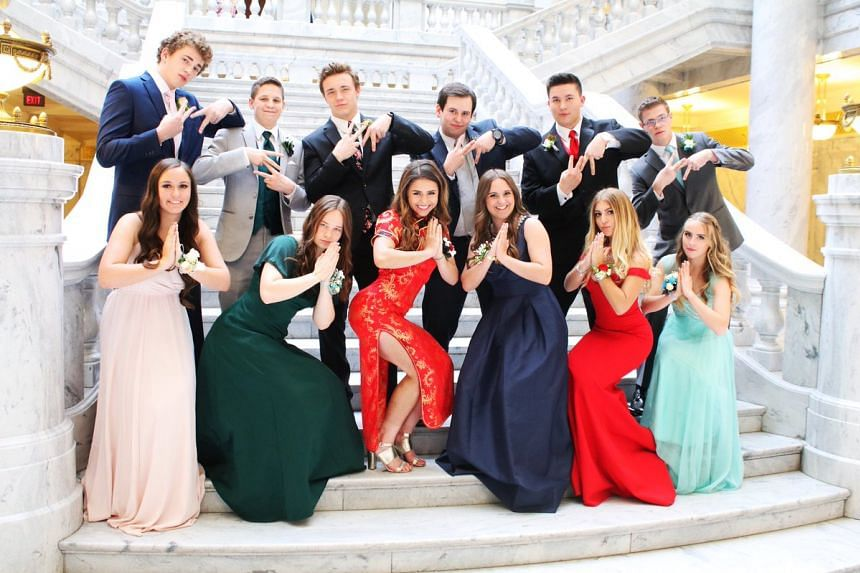 Keziah Daum (front row, third from left) was accused of cultural appropriation after sharing pictures on social media of her prom night.
