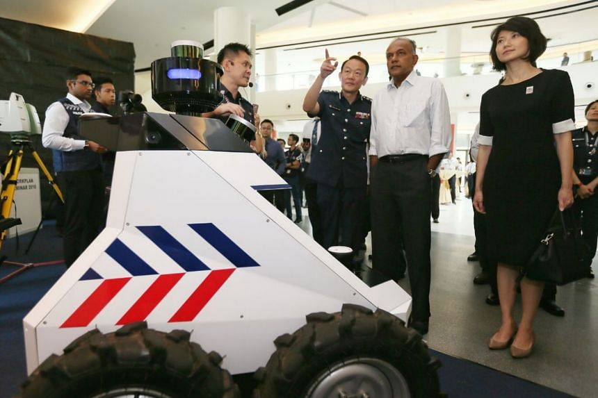 Home Affairs Minister K. Shanmugam being introduced to the Multi-purpose, all-terrain, autonomous robot. Beside him is Commissioner of Police Hoong Wee Teck and Senior Parliamentary Secretary for Home Affairs and National Development Sun Xueling.