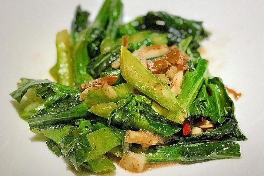Stir fried Gai Lan with slivers of Kelatan salted fish.
