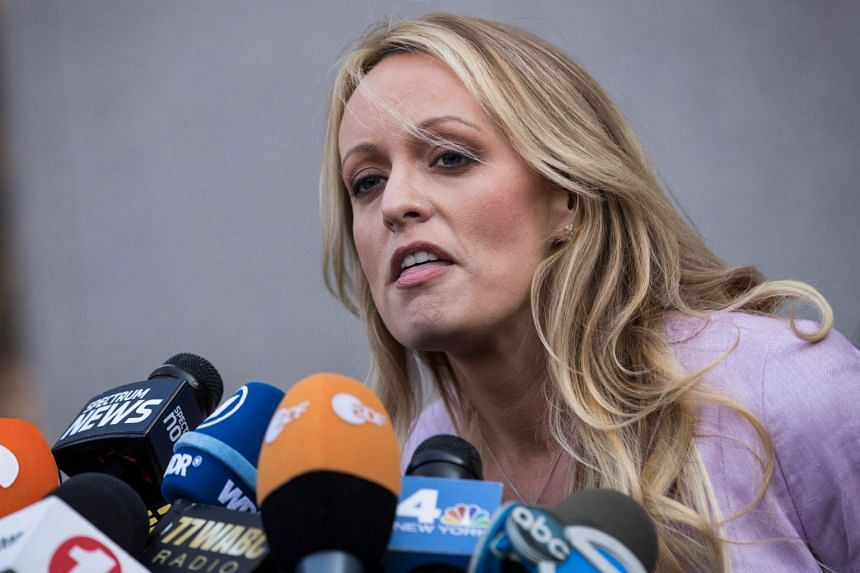Stormy Daniels (Stephanie Clifford) speaks to reporters as she exits New York district court in April 2018.