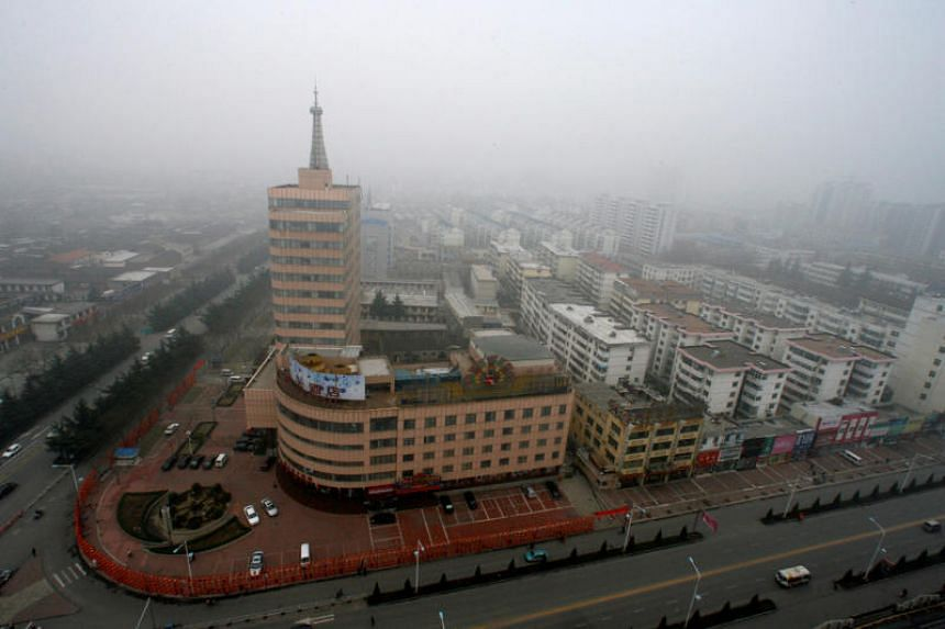 Fog blankets the Jincheng City skyline in north China's Shanxi province.