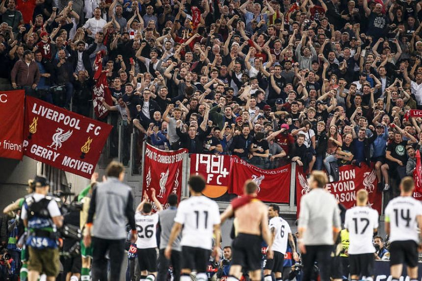 Liverpool players celebrate with fans after the Uefa Champions League semi-final match against AS Roma.