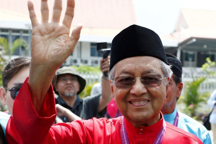 Former Malaysian prime minister and candidate for opposition Alliance Of Hope, Mahathir Mohamad, waves to his supporters after his nomination, on Langkawi island.