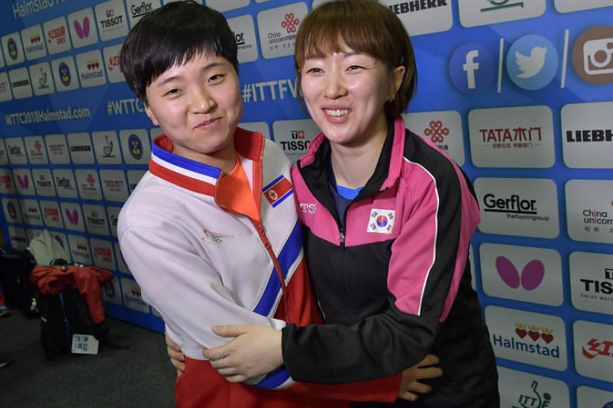 Song I Kim (left) of North Korea and Hyowon Suh of South Korea pose for media at the Table Tennis Team World Championships in Halmstad, Sweden, on May 3, 2018.